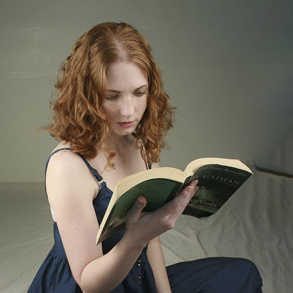 A Beautiful Girl Reading A Book Before Image Retouching Services