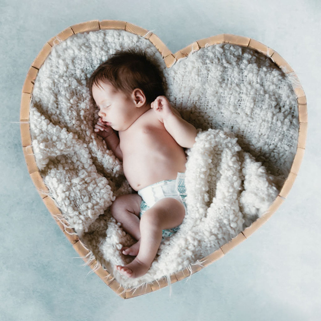 A Child is Sleeping Quietly on a Blanket After Image Manipulation Service