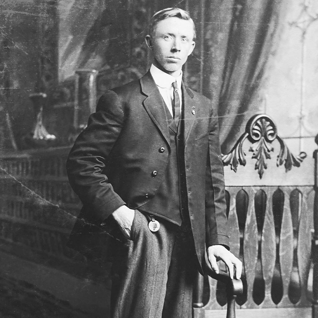 Before Photo Restoration Service: A Man Standing in a Black and White Image