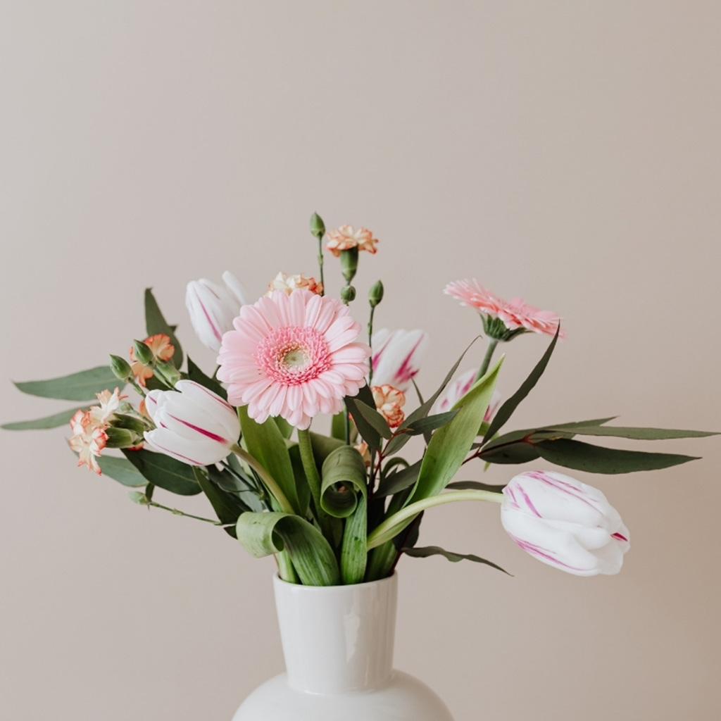 A Bunch of Flowers in a Vase Before Background Removal Services