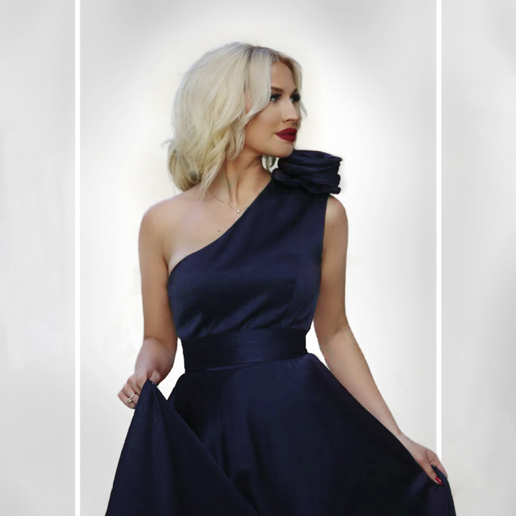 A Stunning Woman With A Gorgeous Dress After Color Correction Services